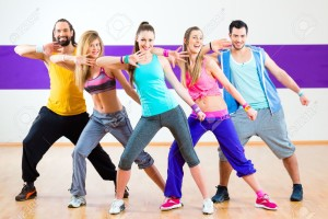 Group-of-men-and-women-dancing-zumba-fitness